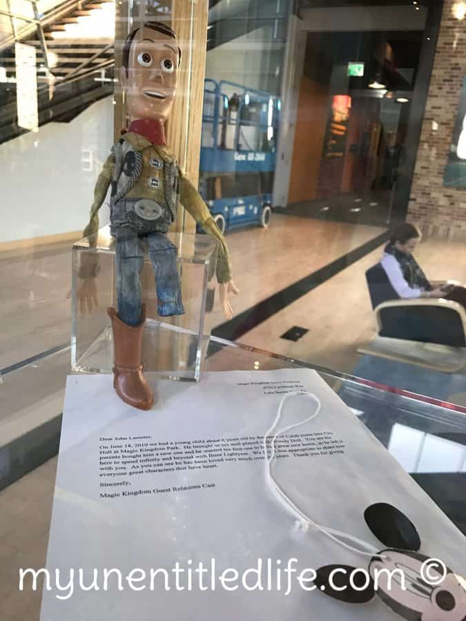 Woody from Toy Story in the Pixar trophy case